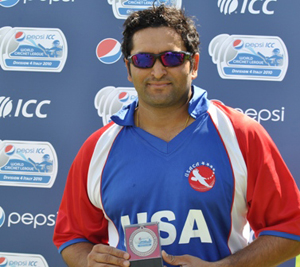 Sushil Nadkarni poses with one of his many International Cricket Council MVP awards. Photo courtesy of ICC.