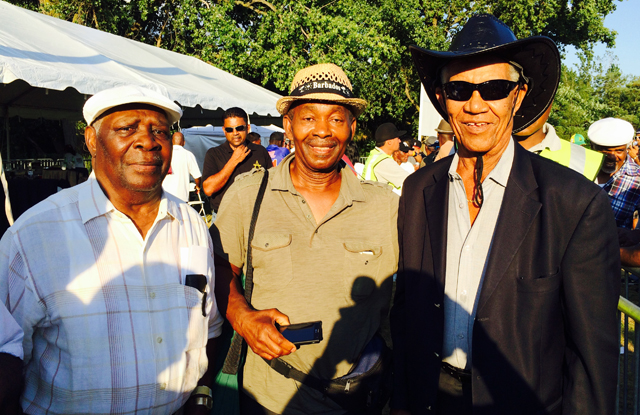 Sir Garfield Sobers (Right) joined by two of his numerous fans.