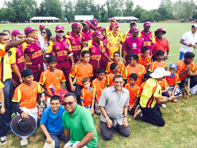 Queens United Youth Cricket Academy youngsters enjoy a photo op with the Windies Legends.