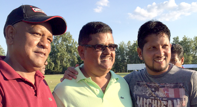 Ramnaresh Sarwan with two fans.