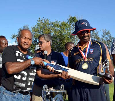 MVP Fazal Alam accepts MVP Newbery Award from Windies Test legend Alvin Kallicharran.