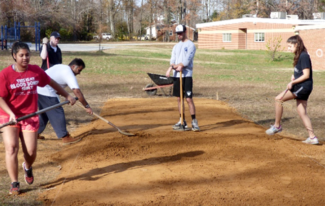 Volunteers helps with making of the pitch at Glenn Dale Elementary School in Bowie, Maryland
