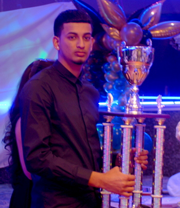Derick Narine of Majestic Cricket Club poses with his MVP trophy. Photo by Shem Rodney