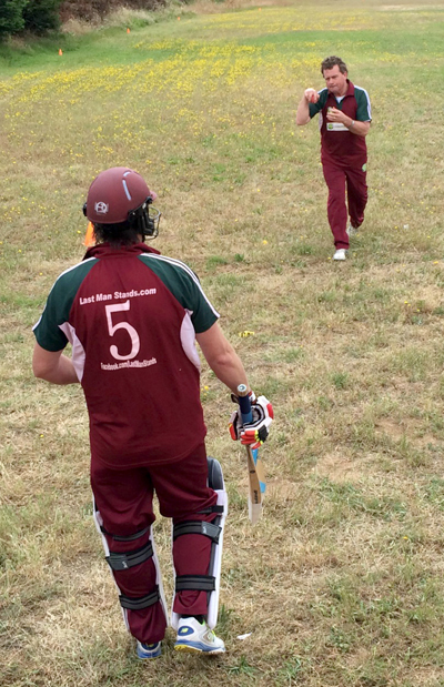 Martin Mackenzie (5) warms up ahead of his knock of 38 off 59 balls with Pete Carson giving him some throwdowns.