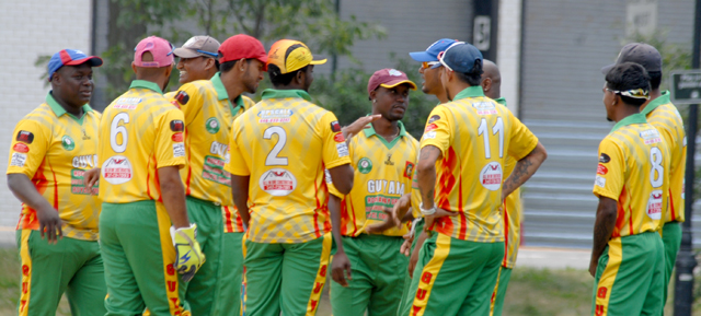 The Guyana team celebrates the fall of wicket during their clash with Bangladesh. Photos by Shiek Mohamed