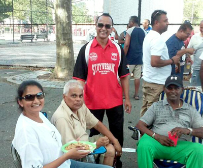 Fans at the game, Dolly Prashad, Krish Prashad, Zaffie Mohamed and Sew Shivnarine. Pictured above is the victorious Atlantis team and supporters with championship trophy.