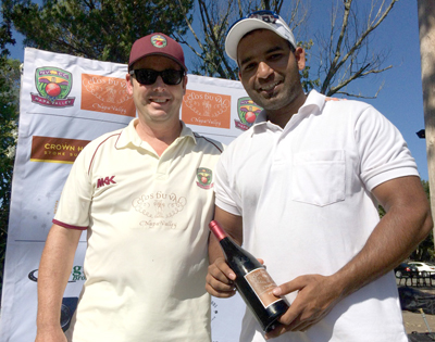 NVCC club captain Rob Bolch (L) presents Param Cheema of the Sonoma Gullies with the Clos du Val Man of the Match Award.