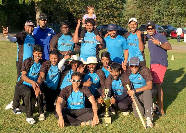 Knights poses with T20 championship.
