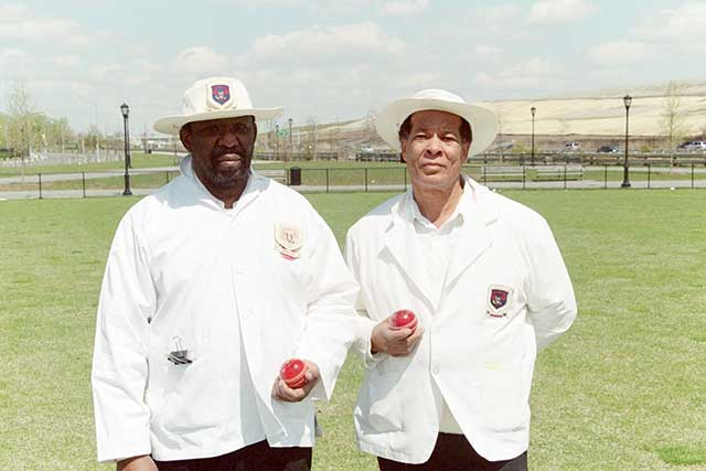 Umpires Carl Patrick and Victor Reeves