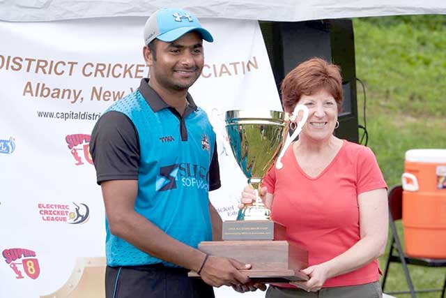 Knights' skipper Raj Ardham collects the winning cup from Mayor Kathy Sheehan.